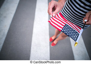 woman hand holding american flag