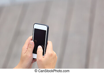 young woman hands hold smart phone