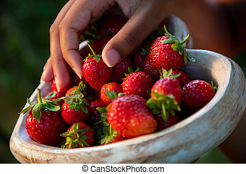 Young Woman Hands Holding Heart Shaped Bowl of Strawberries