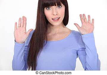 young woman hands up