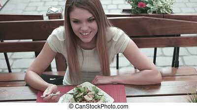 Young Woman Happily Eating Salad
