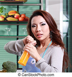 Young Woman Happy with orange juice in the kitchen room