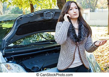 young woman has a car breakdown