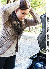woman has a car breakdown