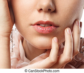 Young woman has chapped lips - Close up of young female...