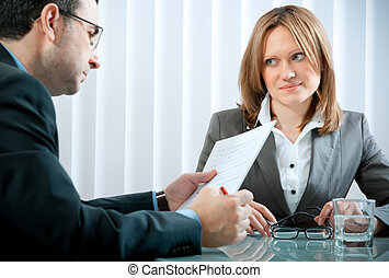 job interview - Young woman having a job interview in a ...