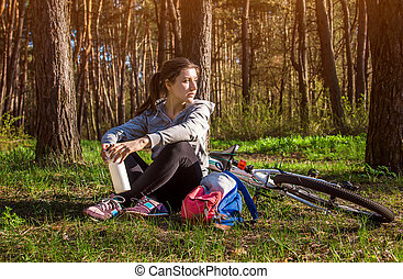 Young woman having a rest after riding a bicycle