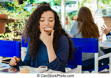 Young woman having breakfast.