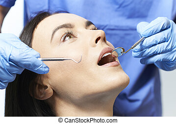 Young Woman Having Check Up And Dental Exam At Dentist