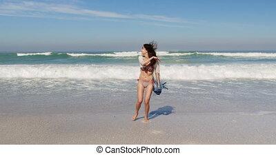 Young woman having fun at beach 4k