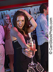Young Woman Having Fun In Busy Bar