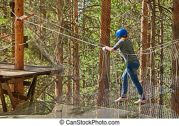 Young woman having fun in rope park