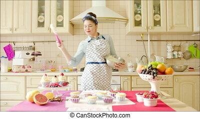 Young woman having fun while cookin