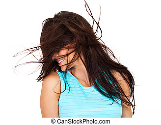 young woman having fun with messy hair