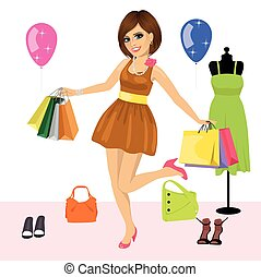 Young woman having fun with shopping bags over women's clothes