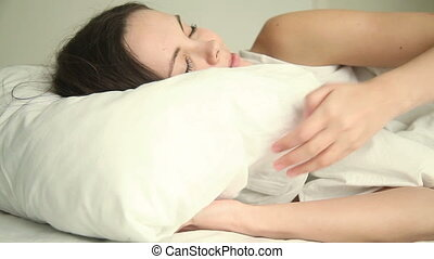 Young woman having good dream - Young beautiful happy adult...