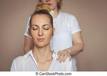Young woman having massage treatment