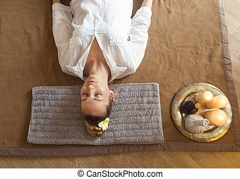 Young woman having massage treatment in spa