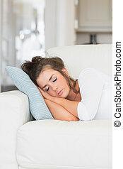 Young woman having nap