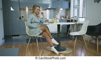 Young woman having nice breakfast