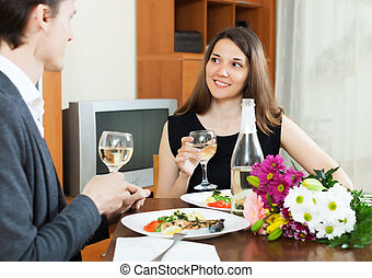 Young woman having romantic dinner with guy