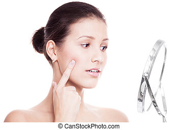 skin problems - young woman having skin problems, looking ...