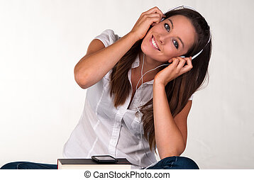 Attractive young girl hearing music with headphones
