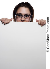 Young woman hiding behind white board