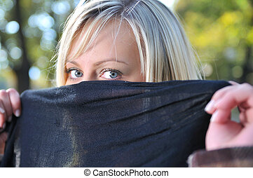 Young woman hiding her face - Young woman hiding face behind...