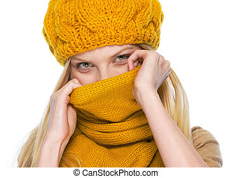 Young woman hiding in scarf