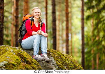 Young woman hiker on a break