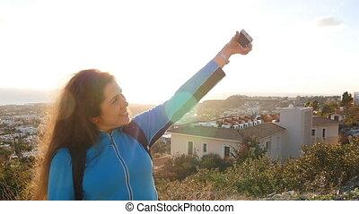 Young woman hiker taking self photo - woman taking self...