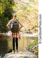 young woman hiking in mountain