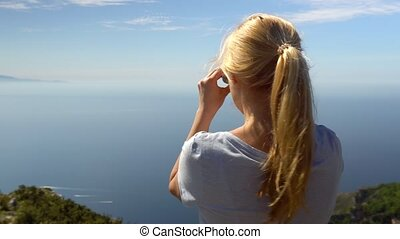 Young woman hiking in mountains over Amalfi coast
