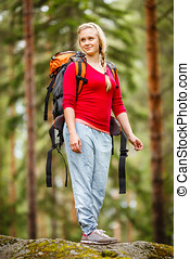 Young woman hiking in the forest.