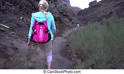 young woman hiking in the gorge - young woman hiking in the...