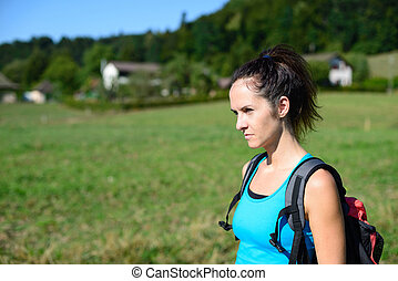 Young woman hiking in the nature