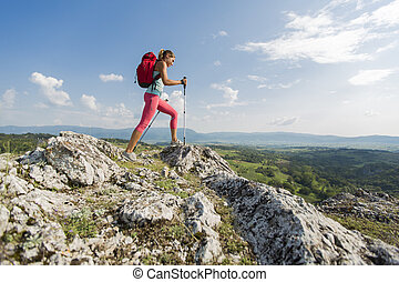 Young woman hiking on the mountain