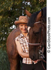 Young woman hold horses head
