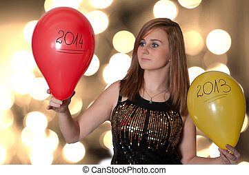 Young Woman holding a balloons on new year