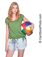 Young woman holding a beach ball