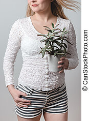 Young woman holding a beautiful Panda plant