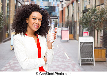 young woman holding a bottle of water