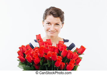 Young woman holding a bouquet of roses