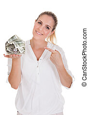 Young Woman Holding A Box Of Currency Over White Background