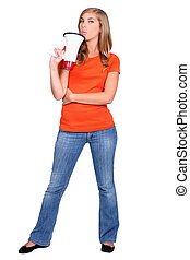 Young woman holding a bullhorn standing in front of white background