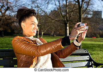 young woman holding a camera