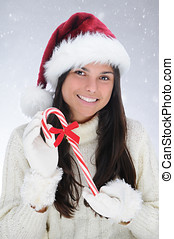Young Woman holding a Candy Cane