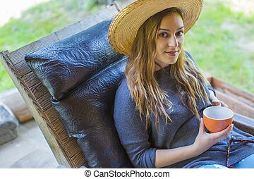 young woman holding a cup of coffee