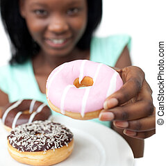 Young woman holding a donut